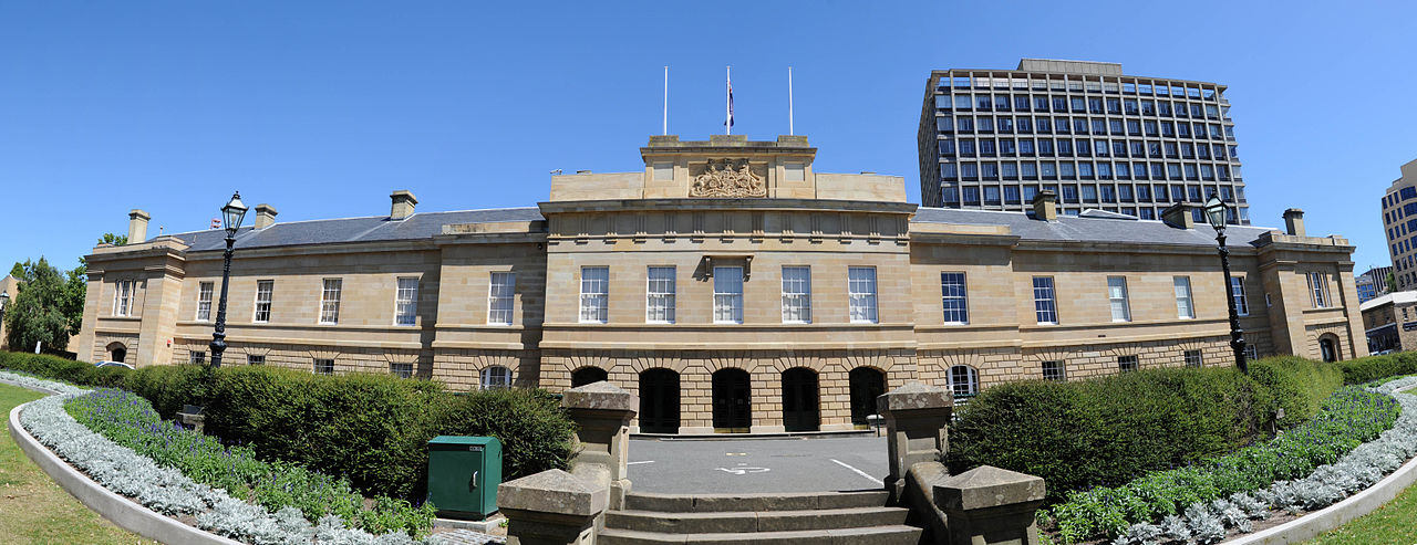 A wide-angle photo of the Tasmanian Parliament building, a grand sandstone building, on a sunny day
